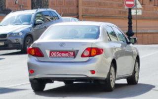Красные номера на машине в России: что означает цвет номерного знака